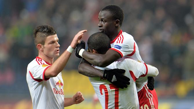 Salzburg's Sadio Mane, right,  Valon Berisha, left, and Alan celebrate after scoring  during the Europa League group C soccer match  between Red  Bull Salzburg and Esbjerg fB  in Salzburg , Austria, Thursday, Dec  12, 2013