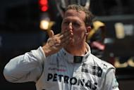 German driver Michael Schumacher blows a kiss to the crowd after the qualifying session for the Monaco Grand Prix. Schumacher rolled back the years on Saturday with the fastest lap in qualifying for Sunday's Monaco Grand Prix, although Australian Red Bull driver Mark Webber will start the race from pole position