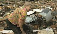 Tornado Survivor Finds Dog During TV Interview