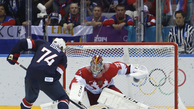 USA forward T.J. Oshie prepares to take a shot against Russia goaltender Sergei Bobrovsky during a shootout in a men's ice hockey game at the 2014 Winter Olympics, Saturday, Feb. 15, 2014, in Sochi, Russia. Oshie scored the winning goal and the USA won 3-2