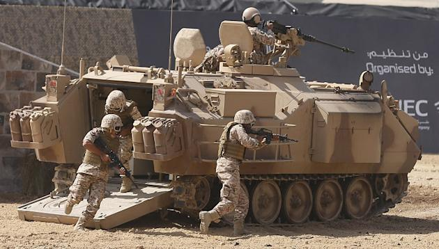 Members of the United Arab Emirates' armed forces take part in a military show launching the International Defence Exhibition and Conference (IDEX) at the Abu Dhabi National Exhibition Centre in the E