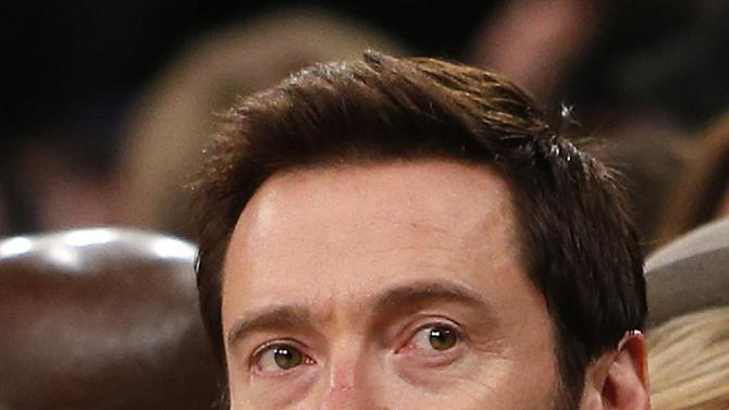 Actor Hugh Jackman attends an NBA basketball game between the Miami Heat and the New York Knicks Saturday, Feb. 1, 2014, in New York.  Miami won 106-91