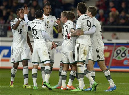 Bayern Munich's players celebrate after scoring during the German Bundesliga first division soccer match against Hanover 96 in Hanover,