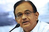 P. Chidambaram, now India's finance minister, speaks with Gujarat media representatives in Ahmedabad on June 13, 2012. India has decided to defer controversial rules to fight tax evasion for two years, the finance minister said on Monday, which should help to ease foreign investor concerns