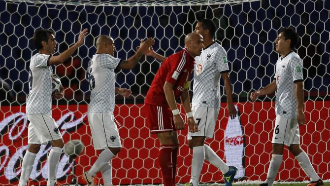 Wael Gomaa, captain of Egypt's Al Ahly, reacts after Cesar Delgado of Mexico's Monterrey scored the fifth goal during their 2013 FIFA Club World Cup football match for the fifth place in Marrakech stadium