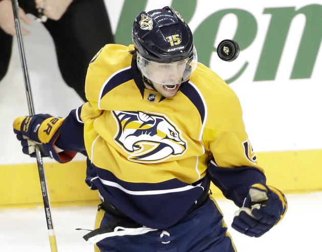 Nashville Predators center Craig Smith tries to control a bouncing puck in the first period of an NHL hockey game against the Detroit Red Wings, Saturday, Feb. 28, 2015, in Nashville, Tenn. (AP Photo/Mark Humphrey)