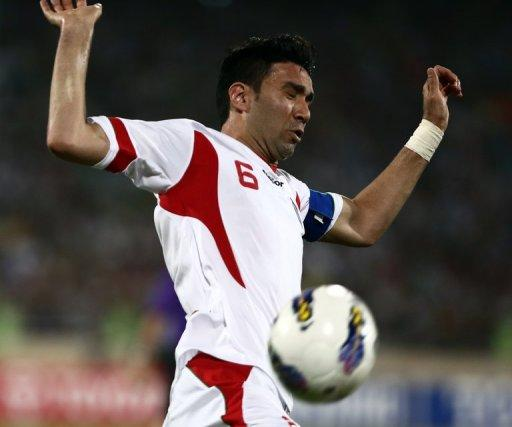 Iran's Javad Nekounam controls the ball during their 2014 World Cup qualifying match against Lebanon, on June 11, 2013