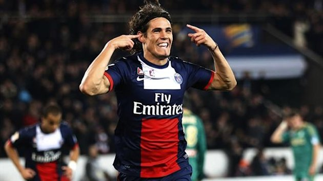 Paris Saint-Germain forward Edinson Cavani celebrates after scoring against Saint-Etienne in the League Cup (AFP)