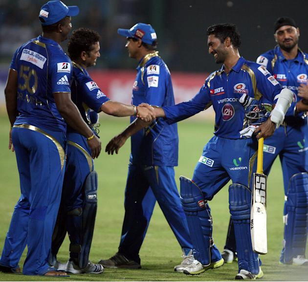 MI players celebrate after wining the 2nd CLT20 semi-final match between Mumbai Indians and Trinidad & Tobago at Feroz Shah Kotla, Delhi on Oct. 5, 2013. (Photo: IANS)