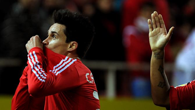 Real Madrid's midfielder Jose Maria Callejon celebrates after scoring during their Spanish league football match Sevilla FC vs Real Madrid on December 17, 2011 at Ramon Sanchez Pizjuan stadium in Sevilla.    AFP PHOTO/ JORGE GUERRERO (Photo credit should read Jorge Guerrero/AFP/Getty Images)