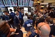 Traders at a post on the floor of the New York Stock Exchange just after the opening bell June 21. US stocks leaped two percent Friday sparked by the dramatic measures adopted in Brussels to stem the eurozone crisis and stimulate growth, giving the markets a strong end to a rocky first half