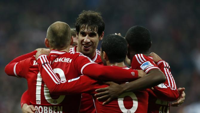 Bayern Munich's Robben, Kroos, Martinez, Thiago and Alaba celebrate a goal during German Bundesliga first division soccer match against Schalke 04 in Munich
