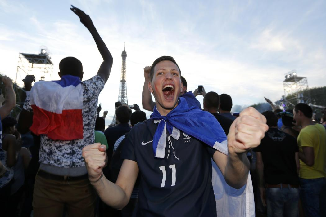 France fans react in the fan zone during a EURO 2016 semi final soccer match