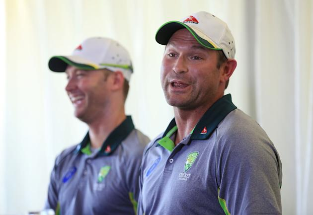 Australia's Ryan Harris, right, who  Saturday July 4, 2015, retired from all forms of cricket due to injury, speaks with the media alongside captain Michael Clarke after the tour match at the at t