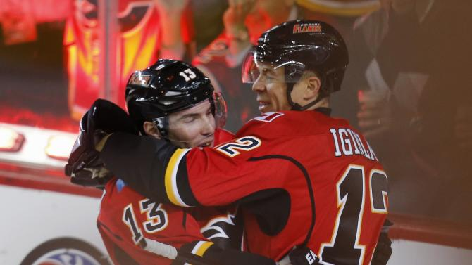 Calgary Flames' Cammalleri celebrates his goal with teammate Iginla during their NHL hockey game against the Dallas Stars in Calgary.