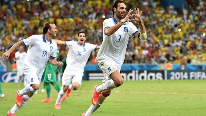 World Cup - Injury time penalty sends Greece through