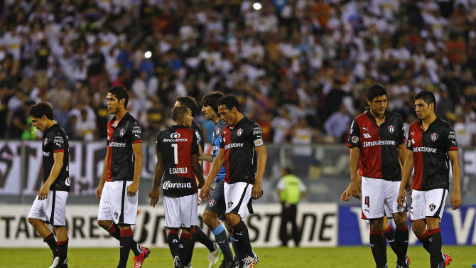 Mexico's Atlas players leave the field after losing their Copa Libertadores soccer match against Chile's Colo Colo in Santiago