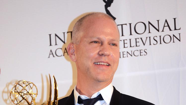 Ryan Murphy poses with his trophy after winning the Founders Award at the 40th International Emmy Awards,  Monday, Nov. 19, 2012 in New York. (AP Photo/Henny Ray Abrams)