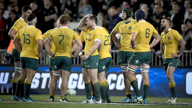 Australian teammates pause during their Bledisloe rugby union test match loss to New Zealand in Auckland, New Zealand, Saturday, Oct. 22, 2016. (Dean Purcell/New Zealand Herald via AP)