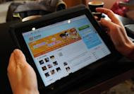 File photo shows a woman checking the Chinese microblogging site Weibo at a cafe in Beijing. Weibo has introduced new terms and conditions punishing those who post comments deemed offensive, as it comes under government pressure to clamp down on bloggers