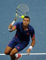 Jo-Wilfried Tsonga of France returns to Novak Djokovic of Serbia during the men's singles final at the China Open tennis tournament in Beijing on October 7, 2012. World number two Djokovic won 7-6, 6-2 to win the China Open for a third time