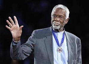 Celtics' legend Russell stands with his Presidential Medal of Freedom during the NBA All-Star basketball game in Los Angeles