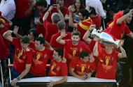 The Spanish national football team parades in Madrid, a day after it won the final match of the Euro 2012 championships 4-0 against Italy in Kiev