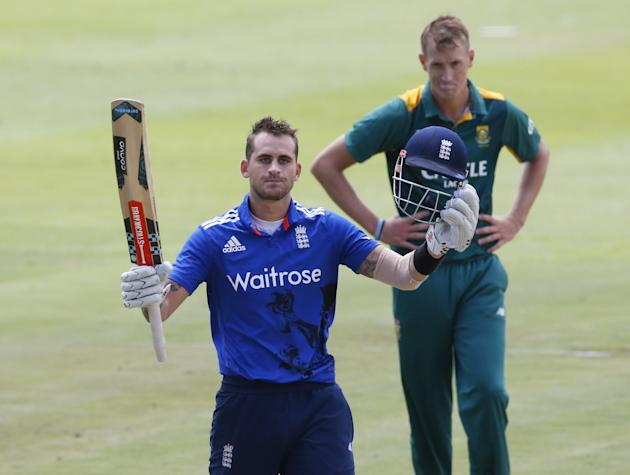 England's Hales celebrates scoring a century as South Africa's Morris looks on during the One Day International Cricket match in Cape Town
