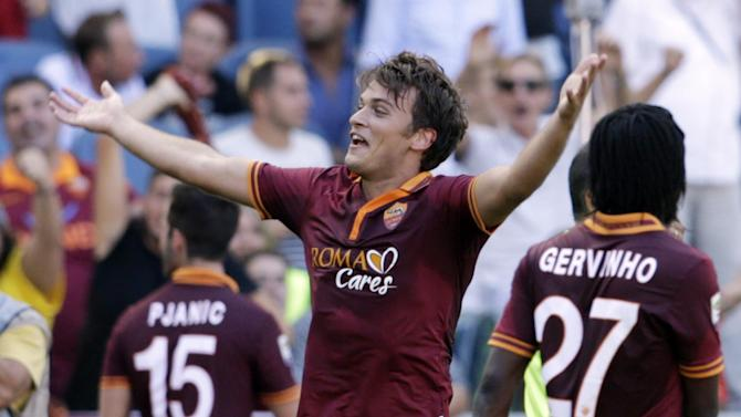 AS Roma forward Adem Ljajic of Serbia celebrates after he scored during a Serie A soccer match between As Roma and Lazio, in Rome's Olympic stadium, Sunday, Sept. 22, 2013