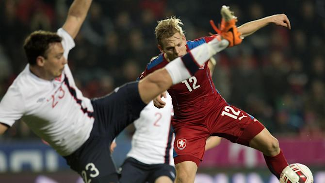Matej Vydra from the Czech Republic, right, fights for the ball with Vegard Forren from Norway, left, during their friendly soccer match in Prague, Czech Republic, Wednesday, March 5, 2014. (AP Photo,CTK/Michal Kamaryt)