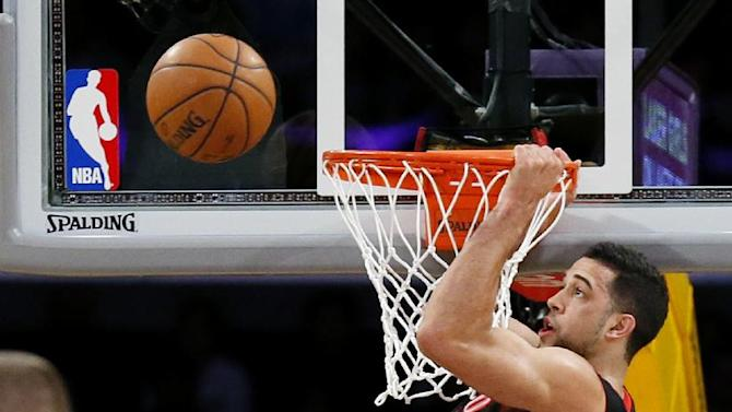 Toronto Raptors' Landry Fields misses a slam dunk attempt as Los Angeles Lakers' Shawne Williams (3) looks on during the first half of an NBA basketball game in Los Angeles, Sunday, Dec. 8, 2013