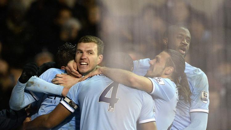 Manchester City's Dzeko celebrates with team mates after scoring a goal against Tottenham Hotspur during their English Premier League soccer match at White Hart Lane in London