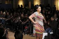 A plus-size model on the catwalk at Shoreditch Town Hall, east London, today. Here, elegantly-dressed women browse racks of clothes designed for European size 40 (UK size 12, US size 8 or 10) and upwards, snacking intermittently from plates of crisps and cupcakes spread around the venue -- food here is not taboo