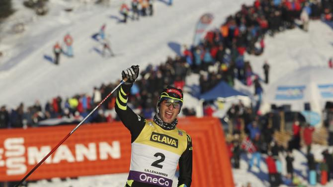 Jason Lamy Chappuis of France crosses the finish line to come in first-placed in the cross country race during the FIS Nordic Combined World Cup competition in Lillehammer
