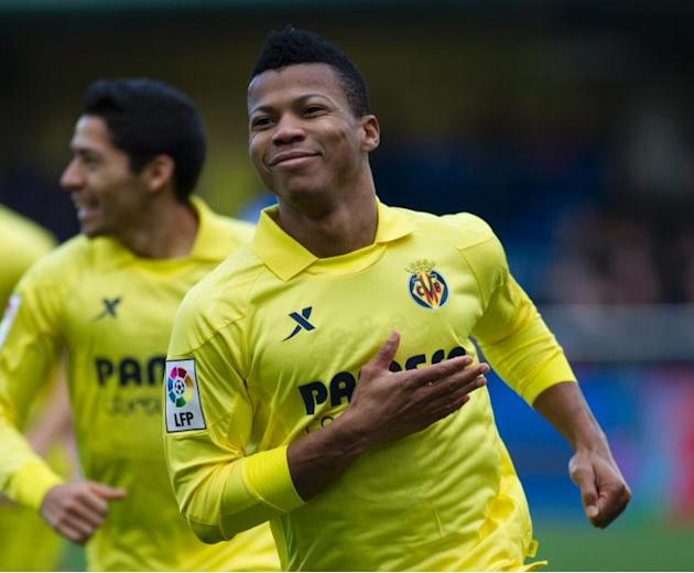 Villarreal's Nigerian forward Ikechukwu Uche celebrates after secoring during the Spanish league football match Villarreal CF vs UD Almeria at El Madrigal stadium in Villareal on January 19, 2014
