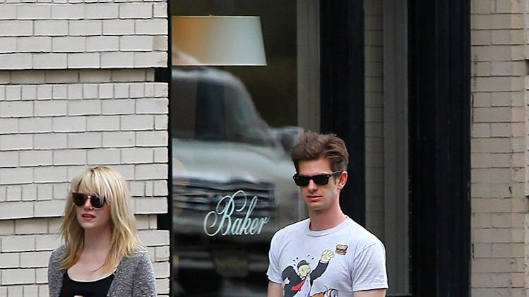 Andrew Garfield and Emma Stone walk their pet dog Ren in NYC