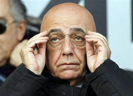 AC Milan's vice president Galliani wears his glasses before the Italian Serie A soccer match against Atalanta in Bergamo