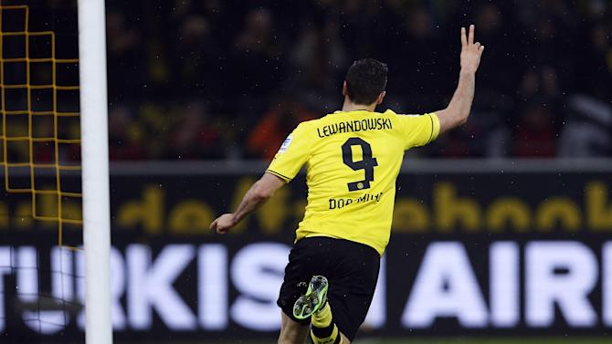 Dortmund's Robert Lewandowski of Poland celebrates after scoring during the German first division Bundesliga soccer match between  BvB Borussia Dortmund and VfB Stuttgart  in Dortmund, Germany, Friday, Nov. 1, 2013