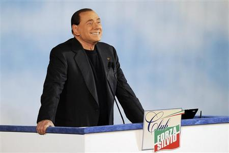 "Former Italian Prime Minister Silvio Berlusconi reacts as he attends a rally to launch the ""Forza Silvio"" (Go Silvio) club in downtown Rome December 8, 2013. REUTERS/Yara Nardi"