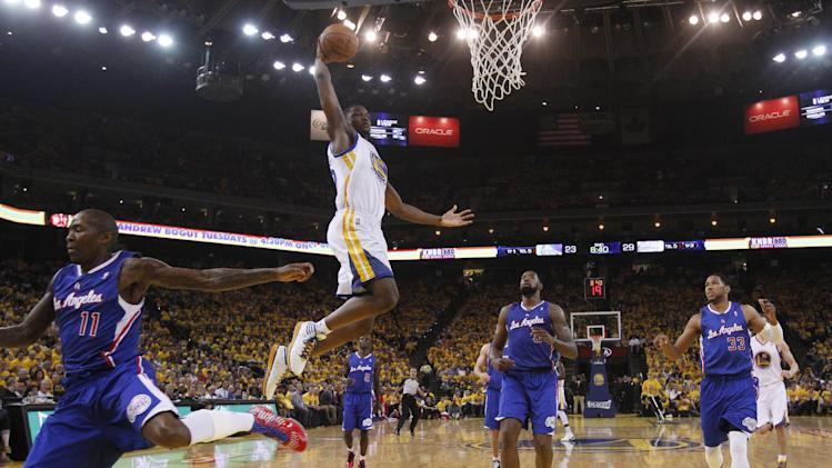 Golden State Warriors' Harrison Barnes, center, goes up for a dunk next to Los Angeles Clippers' Jamal Crawford (11), DeAndre Jordan, center, and Danny Granger (33) during the first half in Game 3 of an opening-round NBA basketball playoff series, Thursday, April 24, 2014, in Oakland, Calif