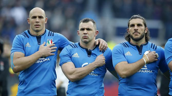Italy's Sergio Parisse, left, lines up for the anthems before the Six Nations rugby union match between England and Italy at Twickenham stadium in London, Sunday, Feb. 26, 2017. (AP Photo/Alastair Grant)