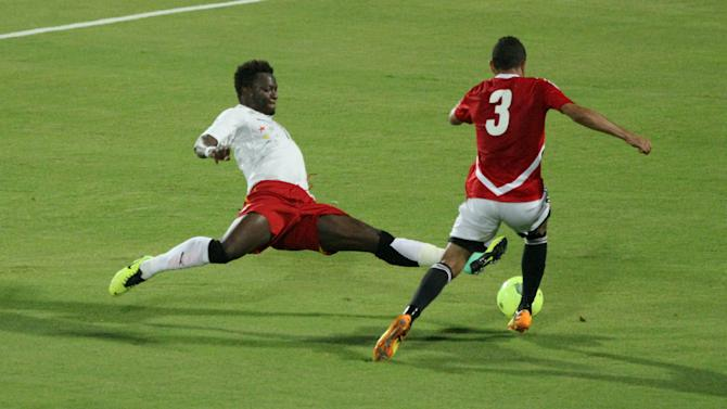 CARIO, Nov. 20, 2013 (Xinhua/IANS) -- Ghana's Sulley Muntar (L) vies for the ball during their 2014 World Cup qualifying second leg playoff soccer match against Egypt in Cario, Egypt, on Nov. 19, 2013. Ghana won 2-1 and qualified for the final stage of 2014 World Cup. (Xinhua/Cai Yang)