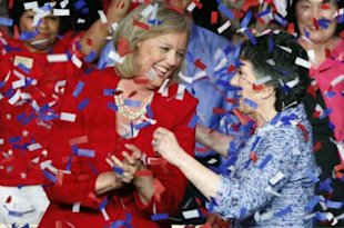 AP Photo: Meg Whitman, left, winner of the Republican nomination for governor of California, and Carly Fiorina, the GOP nominee for the U.S. Senate from California, celebrate at a post-primary election celebration in Anaheim, Calif.