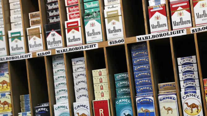 Cigarette packs are displayed at a convenience store in New York, Monday, March 18, 2013. A new anti-smoking proposal would make New York the first city in the nation to keep tobacco products out of sight in retail stores. Mayor Michael Bloomberg says the goal is to reduce the youth smoking rate. The legislation would require stores to keep tobacco products in cabinets, drawers, under the counter, behind a curtain or in another concealed spot. They could only be visible when an adult is making a purchase or during restocking. (AP Photo/Mark Lennihan)