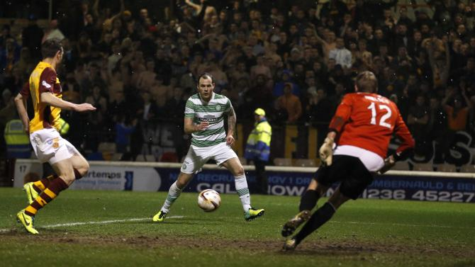 Celtic's Anthony Stokes scores against Motherwell during their Scottish Premier League soccer match at Fir Park Stadium in Scotland
