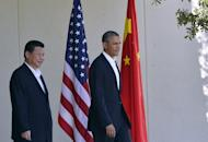 US President Barack Obama welcomes Chinese President Xi Jinping for their bilateral meeting at the Annenberg Retreat at Sunnylands in Rancho Mirage, California, on June 7, 2013. Ditching the crushing formality of US-China summits, Xi and Obama met in Rancho Mirage, California, a playground of past presidents and the powerful