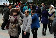 Elderly Chinese dance outdoors at a park beside the Yangtze River in Jiujiang, Jiangxi Province. Hundreds of millions of workers behind Asia's economic miracle are heading into uncertain old age after governments failed to set aside enough funds for their pensions, said a book