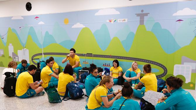 Members of Australia's cycling and water polo teams wait for their flight home at the international airport in Rio de Janeiro, Brazil