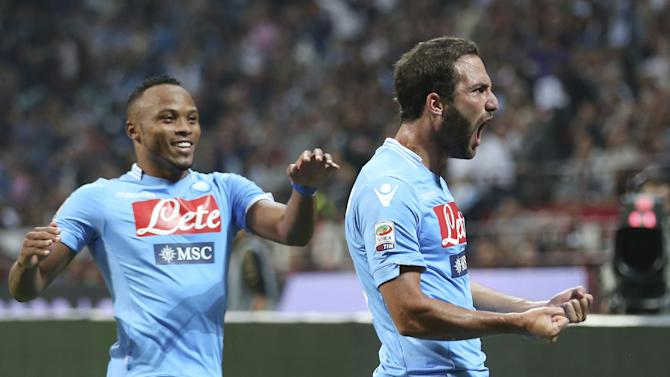 Napoli forward Gonzalo Higuain, right, of Argentina, celebrates with his teammate Camilo Zuniga of Colombia after scoring during the Serie A soccer match between AC Milan and Napoli at the San Siro stadium in Milan, Italy, Sunday, Sept. 22, 2013