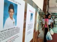 Posters carrying a picture of 12-year-old Nayati Moodliar is posted outside a building in Kuala Lumpur on April 30. He was walking to his Mont Kiara International School located in a posh suburb near Kuala Lumpur when he was kidnapped by two men who bundled him into a car